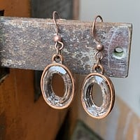 Antiqued Copper Oval Earrings with Clear Oval Swarovski Crystal Embedding.