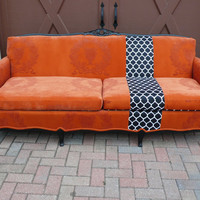 Orange French Provincial couch sofa with black and white geometric stripe