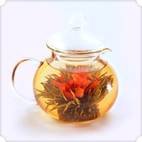 Numi Organic Tea Glass Teapot - Teahouse   Our unique, hand-blown glass teapot is the best way to watch a Flowering Teas™ bloom. It serves up to 14 ounces (420 ml.) of tea.