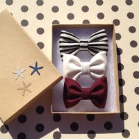 Black and white striped, winter white and burgundy hair bows from Seaside Sparrow. Perfect gift for her.