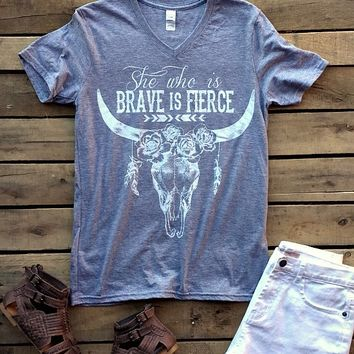 Our She Who Is Brave Short Sleeve Tee is one of our staff's faves! It's a v-neck short sleeve tee with ''She who is brave is fierce'' on the front with bull head skull and flowers. Very comfortable and stylish!