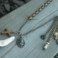 Voodoo Bone and Tooth Charm Necklace by InkandRoses13