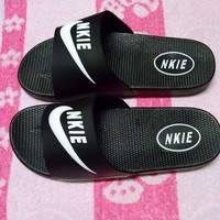 Nike: slippers for men and women casual non slip beach shoes black female slippers