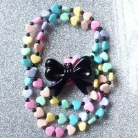 Fairy Witch III - Pastel Rainbow Hearts and Black Bow Stretch Necklace  from On Secret Wings
