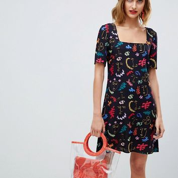 Reclaimed Vintage inspired cami dress with faces print at asos.com