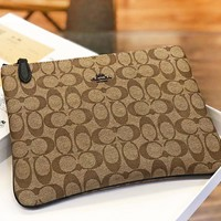 COACH New fashion pattern leather couple cosmetic bag file package handbag