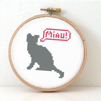 Gray cat cross stitch pattern. Silhouette of animal saying Miau. Use as modern decoration in your home or make as gift for puss lover