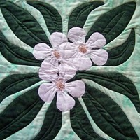 White Plumeria Wall Hanging with Green Leaves and Beads in Centers
