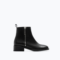 Zipped furry leather bootie