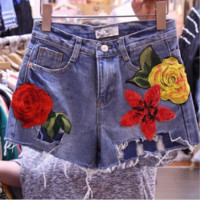 The hot flower embroidery cowboy jeans shorts pants for women