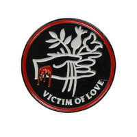 VICTIM OF LOVE LAPEL PIN