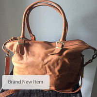 Tan leather tote. The best shoulder, cross body bag. Lots of room, side pockets, fully lined. Durable genuine leather, customise it to suit.