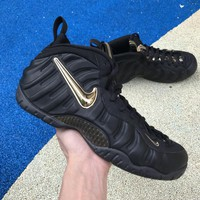 "Nike Air Foamposite Pro ""Black / Metallic Gold"" Sneakers"