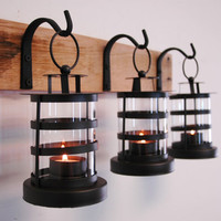Black Round Tea Light Candle Lantern Trio Wall Decor hanging from wrought iron hooks for unique wall decor, home decor, bedroom decor