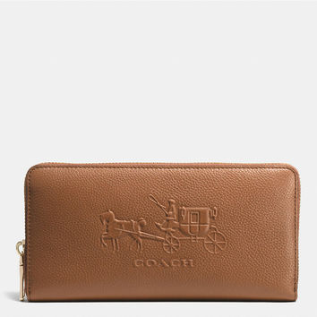 EMBOSSEDhorse and carriage accordion zip walletin leather