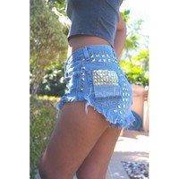 Levi High waisted denim shorts distressed frayed studded jeans