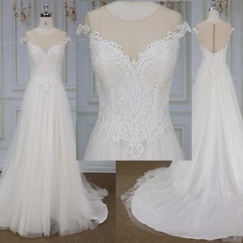 Style YBW1954 off the shoulder plus size bridal dress from Darius Cordell