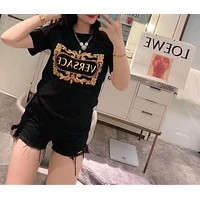 """""""VERSACE"""" Woman Leisure Fashion Letter Personality Printing  Hedging Crew Neck Short Sleeve Motion Tops"""