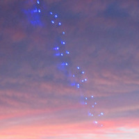 Romantic sunset with blue lights in the sky a photo