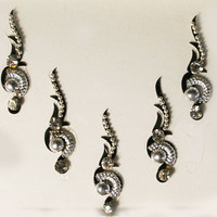Silver Swirl & Curved Bindi with Crystal with Black Background.