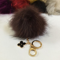 Fur pom pom keychain, bag pendant with flower charm in brown
