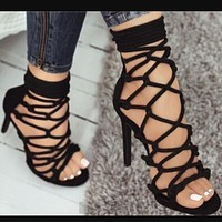 The new high heel sandals feature a culowed-out round head, side zipper, and ankle strap