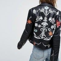 Blank NYC Leather Look Biker Jacket with Painted Flowers at asos.com