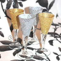 Set of 4 hand decorated 'pixie' shot/sherry Glasses, 2 x silver, 2 x gold