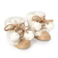 CUPCAKES & CARTWHEELS FAUX FUR AND SUEDE BOOTS WITH POM POMS