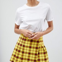 ASOS DESIGN tailored mini skirt in check with pleats at asos.com