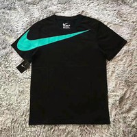 NIKE is selling short - sleeved t-shirts with big - hook prints