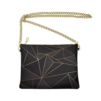 Abstract Black Polygon with Gold Line Crossbody Bag With Chain by The Photo Access