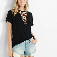 Express One Eleven Deep V-neck Lace Up Tee from EXPRESS