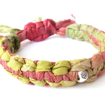 Sari silk ribbon bracelet with Sterling silver beads, lime & poppy recycled fabric from Nepal, om charm