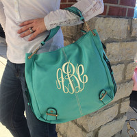 MONOGRAM Turquoise Colored Leather Purse Font shown MASTER CIRCLE in ivory
