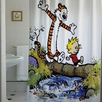 calvin and hobbes shower curtain that will make your bathroom adorable