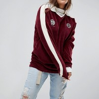Puma Exclusive To ASOS Plus Velvet Football Jersey In Burgundy at asos.com