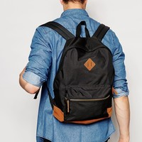 ASOS Backpack In Black With Contrast Faux Suede Base at asos.com