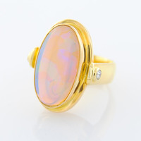 Crystal Opal 20 mm x 12 mm with two 10 point Diamonds and set in an 18K Yellow Gold Ring