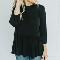 Ruffle Neck Peplum in Black