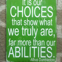 It is our choices that show what we truly are, far more than our abilities. Albus Dumbledore. Harry Potter. Wooden Sign. Wood.
