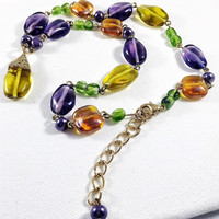 Mardi Gras glass bead necklace, yellow and green glass bead, amber and purple glass bead, yellow and gold teardrop pendant, art glass
