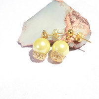 Yellow and gold stud earrings