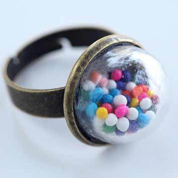 Small glass dome ring with cake sprinkles