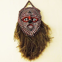 Vintage African tribal mask, wall hanging, face in black with white and red markings