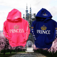 """Two """"princess"""" and """"prince"""" youth hoodies,swetshirts, one pink one royal blue."""