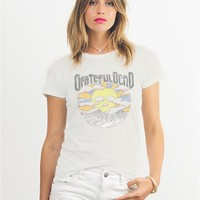 Featuring soft ivory color jersey tee, Grateful Dead image with sun rising and Grateful Dead logo print on front and dancing skeleton with top hat print at back, form fitting basic garment dyed, scoop neckline.