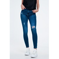 Distressed Skinny Fit Jeans In Mid Wash