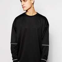 ASOS | ASOS Oversized Sweatshirt In Scuba With Contrast Piping at ASOS