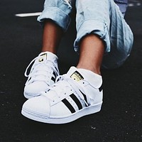 """Adidas"" Shell-Toe Popular Women Men Leisure Flats Sport Running Sneakers Couple Shoes White( Black Line Golden Logo) I"